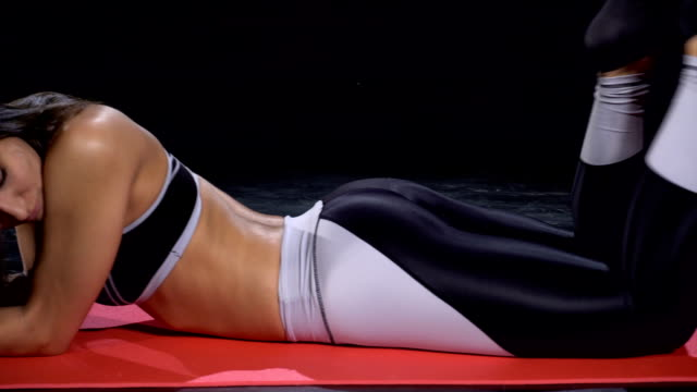 Beautiful fit girl resting on the ground durin workout