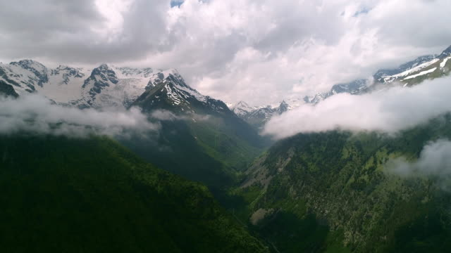beautiful flight in the clouds surrounded by high mountains. - mont blanc stock videos & royalty-free footage