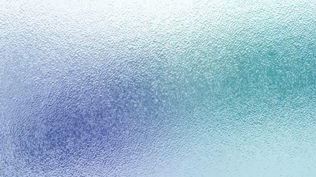 vidéos et rushes de beautiful frosted glass texture and motion light background. - verre translucide