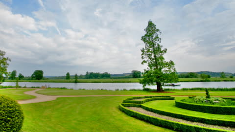 beautiful garden by the river thames - english culture stock videos & royalty-free footage