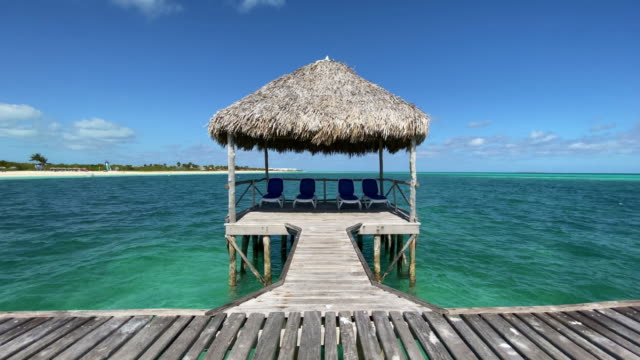 beautiful gazebo on tropical white sandy beach - tourist resort stock videos & royalty-free footage