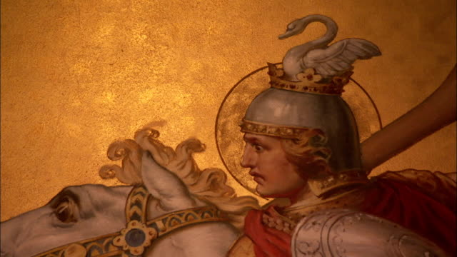 A beautiful gilded mural of George slaying the dragon decorates one of the walls in the throne hall of Neuschwanstein Castle. Available in HD.