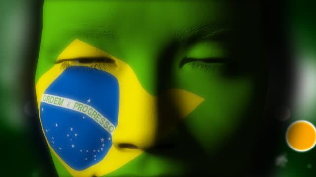vídeos de stock, filmes e b-roll de linda garota bandeira brasileira rosto pintado - bandeira