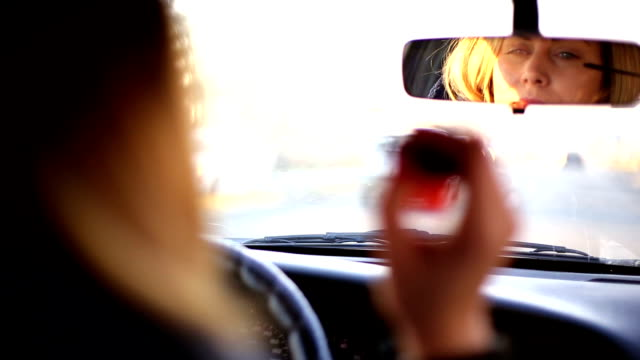 beautiful girl checking her makeup in her car - distracted stock videos & royalty-free footage