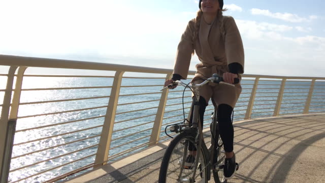 beautiful girl cycling - casual clothing stock videos & royalty-free footage