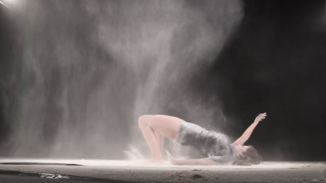 Beautiful girl dancing with powder