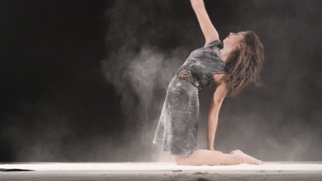 beautiful girl dancing with powder - modern dancing stock videos & royalty-free footage