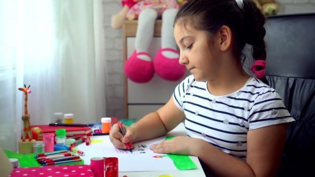 beautiful girl doing homework - crayon stock videos and b-roll footage