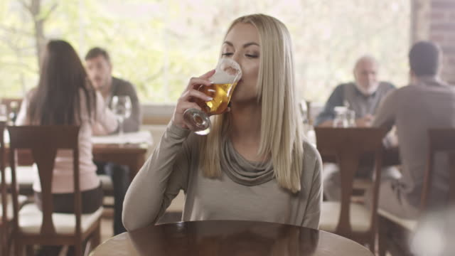 beautiful girl drinking beer - beautiful people stock videos & royalty-free footage