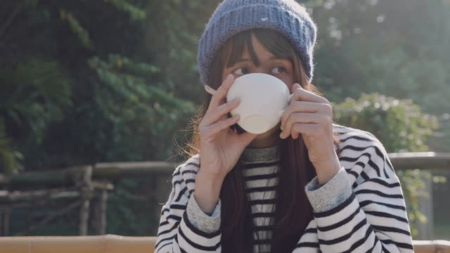 beautiful girl drinking hot tea at river in morning. - tea hot drink stock videos & royalty-free footage