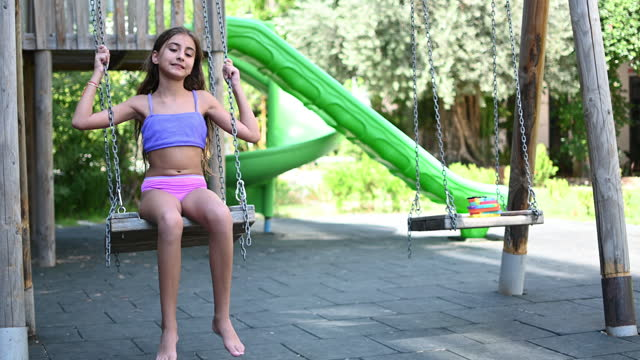 stockvideo's en b-roll-footage met beautiful girl enjoying to swing - badkleding