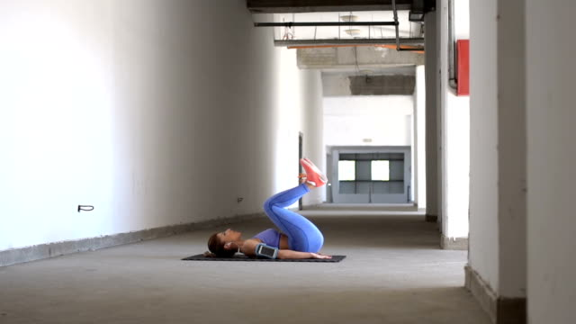 beautiful girl exercising alone - lying on back stock videos and b-roll footage