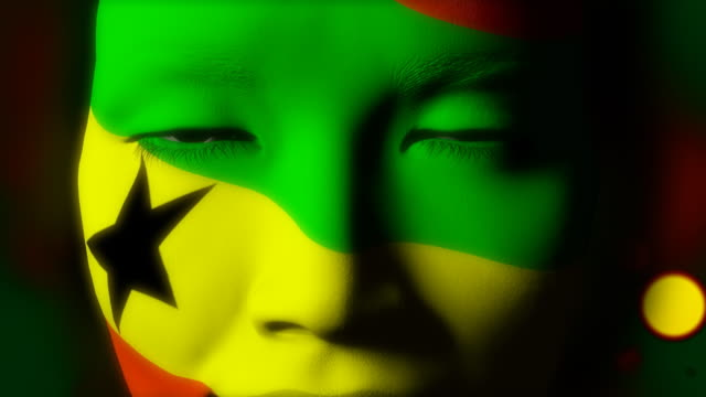 Beautiful girl Ghana flag face painted