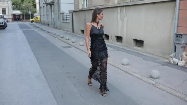 beautiful girl in black dress - black dress stock videos & royalty-free footage