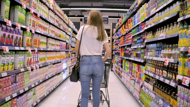beautiful girl is shopping at the market mall. - groceries stock videos & royalty-free footage