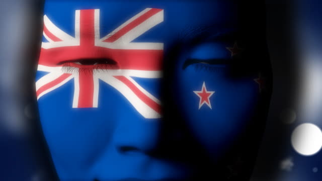 Beautiful girl New Zealand flag face painted
