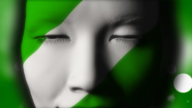 beautiful girl nigerian flag face painted - nigerian flag stock videos & royalty-free footage