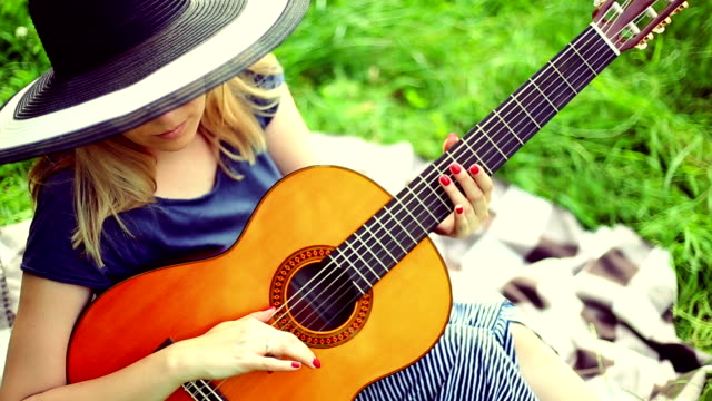 beautiful girl playing the guitar - plucking an instrument stock videos and b-roll footage