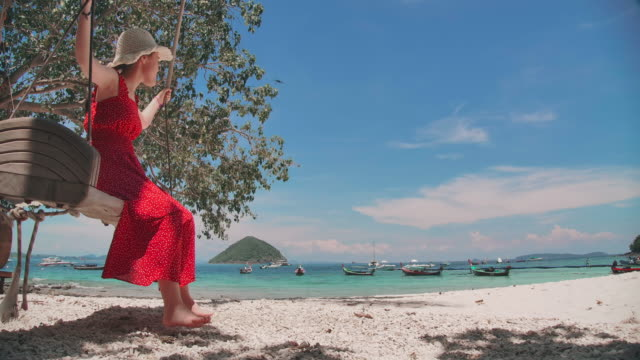 beautiful girl playing vintage swing on the beach - phuket stock videos & royalty-free footage