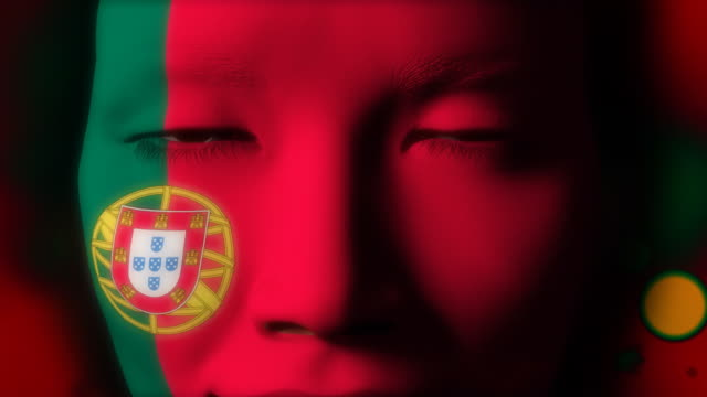 Beautiful girl Portugal flag face painted
