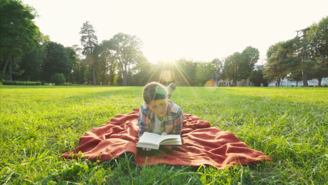 beautiful girl reading a book. - resting stock videos & royalty-free footage