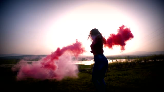 beautiful girl runs and spins around with a pink smoke grenade, slow motion - hand grenade stock videos & royalty-free footage