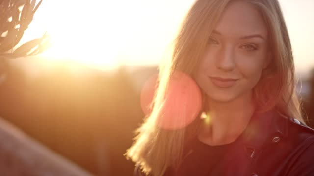 beautiful girl smiling in the sunlight - leather jacket stock videos & royalty-free footage
