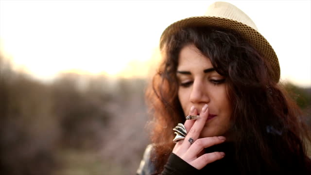 beautiful girl smoking marijuana - smoke physical structure stock videos & royalty-free footage