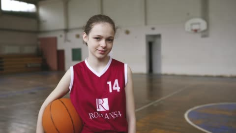beautiful girl standing in front of coach and teammates on practice - girls stock videos & royalty-free footage