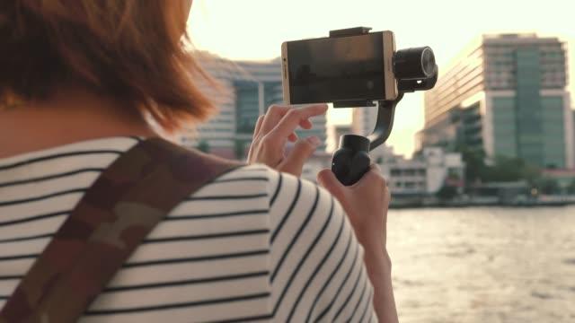 Beautiful girl taken pictures Of Chao Phraya River, Bangkok, Thailand.