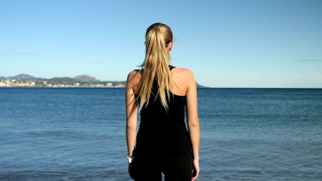 beautiful girl thinking and looking at sea view - standing stock videos & royalty-free footage