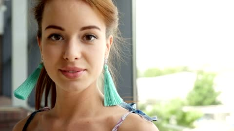 beautiful girl twists her head and smiles. slow motion video - 25 29 years stock videos & royalty-free footage