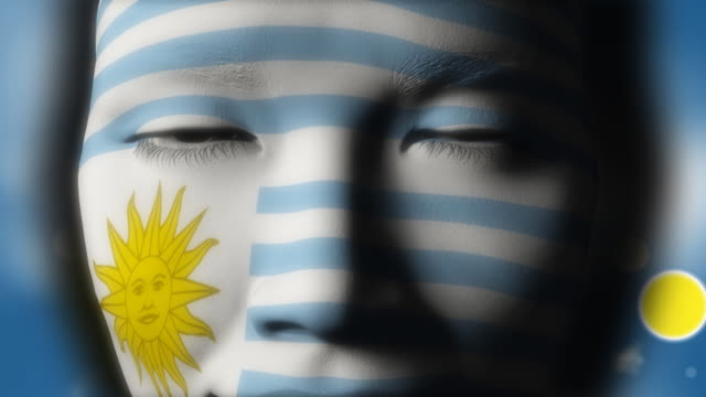 beautiful girl uruguay flag face painted - uruguaian flag stock videos & royalty-free footage
