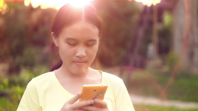 beautiful girl using a smartphone at sunset - electronic organiser stock videos & royalty-free footage