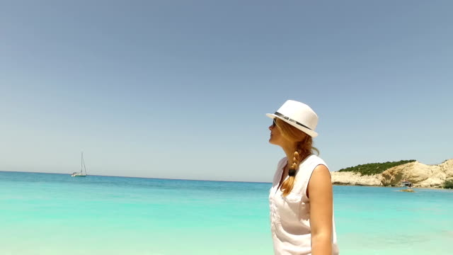 Beautiful girl walking along the sea