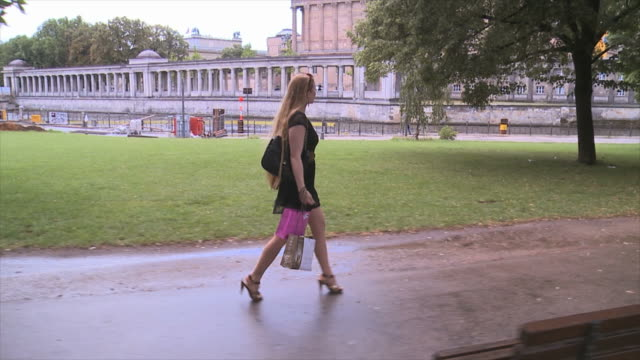 Beautiful girl walking in Berlin city on the waterside