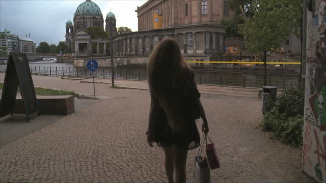 beautiful girl walking in berlin city on the waterside - long hair stock videos & royalty-free footage