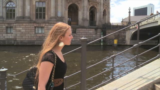 beautiful girl walking in berlin city on the waterside - high heels stairs stock videos & royalty-free footage