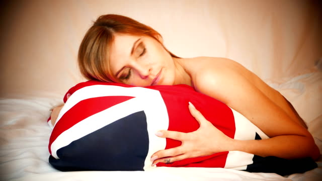 a beautiful girl with a royal scepter and a crown rests on a british flag - embassy stock videos & royalty-free footage