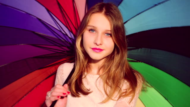 beautiful girl with colorful umbrella