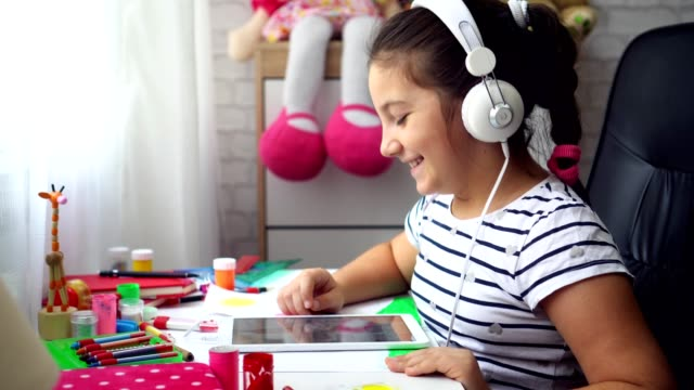 beautiful girl with headphones using a digital tablet - headphones stock videos & royalty-free footage