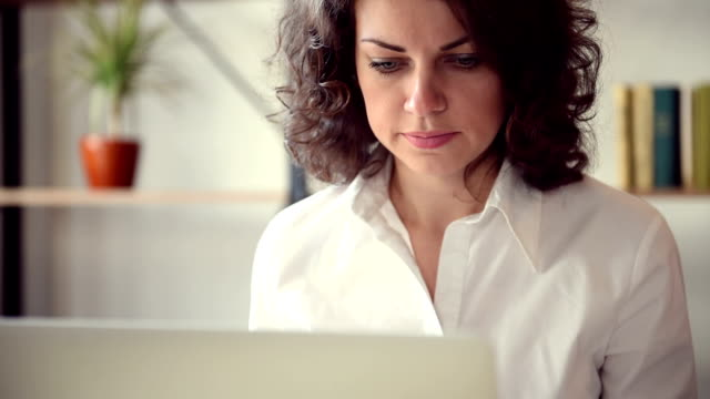 beautiful girl with laptop - white shirt stock videos & royalty-free footage
