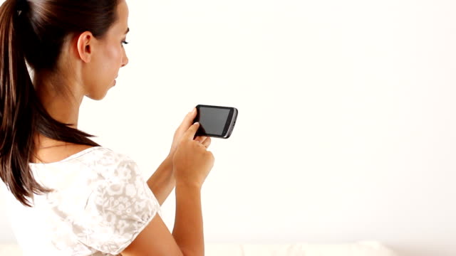 beautiful girl with smart phone - photograph album stock videos and b-roll footage
