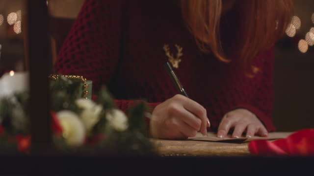 beautiful girl writes a letter to santa claus. - correspondence stock videos & royalty-free footage