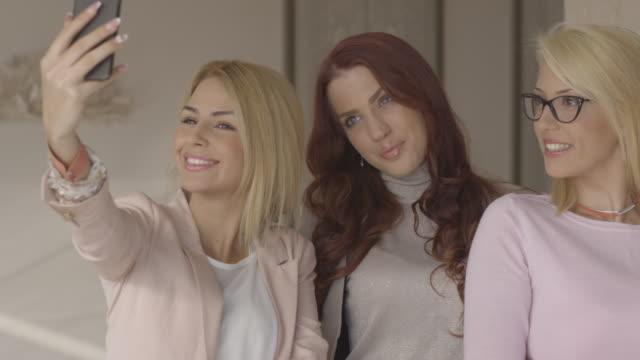 beautiful girls taking selfie in restaurant. - coffee table stock videos & royalty-free footage