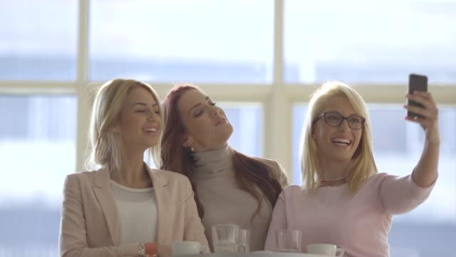 beautiful girls taking selfie in restaurant. - only girls stock videos & royalty-free footage
