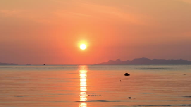 beautiful golden beach and big sea sunset at samui island thailand - beauty in nature stock videos & royalty-free footage