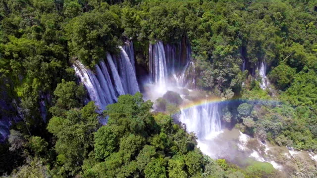 Beautiful Great Waterfall with Rainbow in Deep Forest