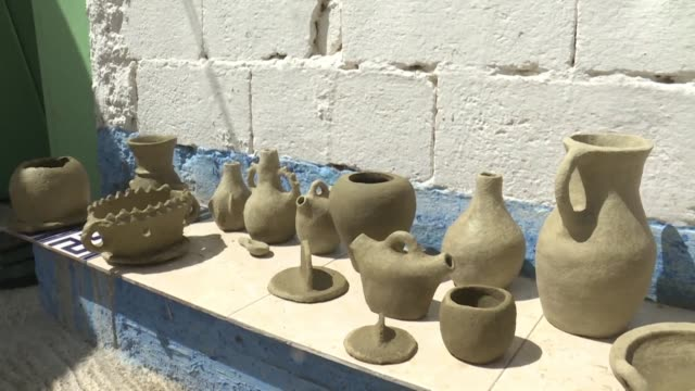 beautiful handcrafted pottery made by mama aicha rarely sells in morocco anymore but thanks to social media her ancient techniques are drawing... - foothills stock videos & royalty-free footage
