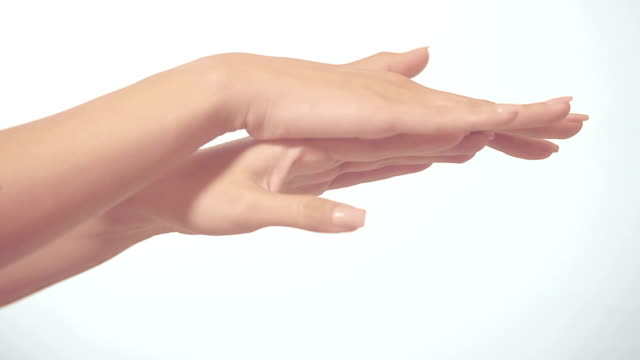 Beautiful hands massaging against white background